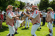 Thaxted Morris Weekend 3-4 June 2017<br /> A meeting of member clubs of the Morris Ring celebrating the 90th anniversary of the founding of the Thaxted Morris Dancing side or team in Thaxted, North West Essex, England UK. <br /> The Thaxted Morris side dancing and drinking beer at The Horse and Groom pub at Cornish Hall End, Essex.<br /> Hundred of Morris dancers from the UK and this year the Silkeborg side from Denmark spend most of Saturday dance outside pubs in nearby villages where much beer is consumed. In the late afternoon all the sides congregate in Thaxted where massed dancing is perfomed along Town Street. As darkness falls across Thaxted the spell binding Abbots Bromley Horn Dance is performed to the sound of a solo violin in the dark.