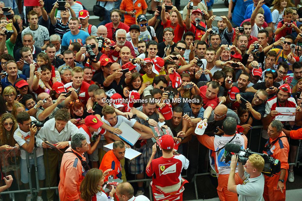 Kimi Raikkonen (FIN) Ferrari signs autographs for the fans in the pit lane.<br /> Italian Grand Prix, Thursday 4th September 2014. Monza Italy.