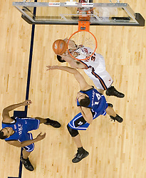 Virginia's Jason Cain (33) dunks over Duke's David McClure (14).  The University of Virginia Cavaliers beat the #8 ranked Duke University Blue Devils 68-66 in overtime at the John Paul Jones Arena in Charlottesville, VA on February 1, 2007...
