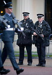 © London News Pictures. 09/05/2012. London, UK.  Armed police watch preparations for  Opening of Parliament on May 09, 2012 in London. In a speech to Members of Parliament and Peers in The House of Lords, Queen Elizabeth II will officially open a new session of parliament, which will set out the government's agenda and legislation for the coming year. Photo credit: Ben Cawthra/LNP