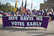 Davis High School students march in a parade through the surrounding neighborhood to promote the beginning of voting season.<br />
