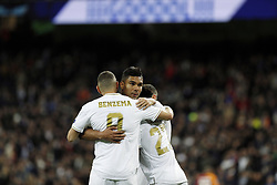 November 6, 2019, Madrid, Spain: Real Madrid CF's Carlos H. Casemiro, Karim Benzema (L) and Rodrygo Goes (M) celebrates after scoring a goal during the UEFA Champions League match between  Real Madrid and Galatasaray SK at the Santiago Bernabeu in Madrid. (Credit Image: © Manu Reino/SOPA Images via ZUMA Wire)
