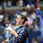 Flavia Pennetta, Italy, shows the trophy to Italian Prime Minister Matteo Renzi after her victory over Roberta Vinci, Italy, in the Women's Singles Final match during the US Open Tennis Tournament, Flushing, New York, USA. 12th September 2015. Photo Tim Clayton