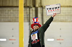 Tom Green of New Jersey hold high a sign in support of Republican candidates at a rally of Mike Pence, Vice-presidential candidate for the Republican Party, in Bensalem, PA.