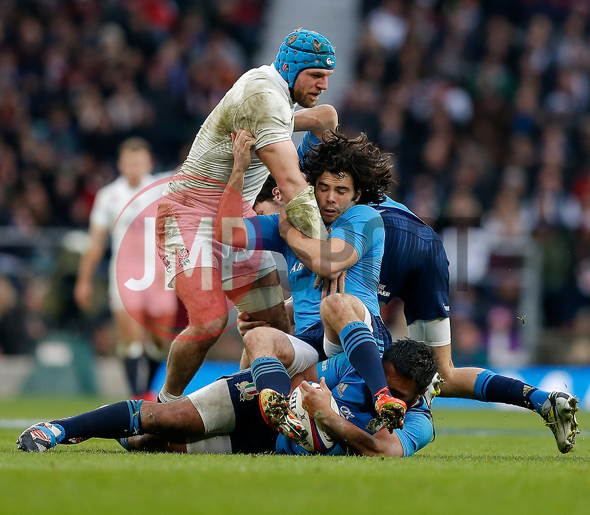 England Flanker James Haskell is grappled by Italy Full Back Luke McLean - Photo mandatory by-line: Rogan Thomson/JMP - 07966 386802 - 14/02/2015 - SPORT - RUGBY UNION - London, England - Twickenham Stadium - England v Italy - 2015 RBS Six Nations Championship.