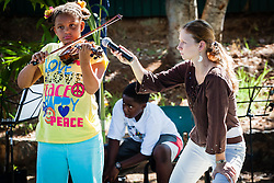 Chantel Carty 9 years old plays the violin.  een here with Kelsey Morrison 12th grade.  2012 Peace Day Celebration.  VI Montessori School and International Academy.  21 September 2012.  © Aisha-Zakiya Boyd