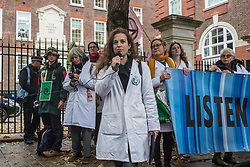 London, UK. 22 November, 2019. Dr Emily Grossman addresses climate activists from Scientists for XR outside the headquarters of the Conservative Party during a demonstration intended to communicate the science relating to the climate and ecological emergency. Activists were dressed in labcoats to represent the 1600 scientists worldwide who have signed the Scientists Declaration in support of non-violent direct action against government inaction against the climate and ecological emergency.