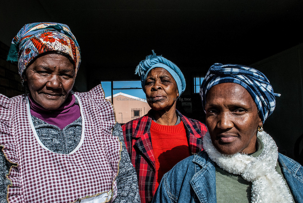 Three Women of Noncedo Old Age Home in Addo.<br /> Addo, Eastern Cape, South Africa, 2011.<br /> <br /> These three women tirelessly give their time, energy and support to the only old age home in the Addo area. The old-age home shares its fence with the town school. In addition to their work for the elders in their community, these women also provide one hot, home-cooked meal a day for children after school.