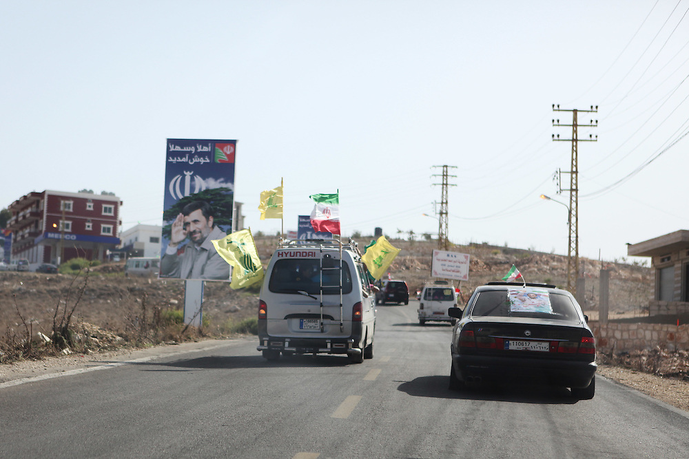 On the second and final day of his visit to Lebanon, Iranian President Mahmoud Ahmadinejad traveled to the southern town of Bint Jbeil. There a Hizballah-organized rally was held to welcome Ahmadinejad to the south Lebanon, an area where Hizballah is widely supported. Tens of thousands gathered for hours holding flags of Iran, Hizballah, Lebanon and other political parties, cheering the Iranian president as he arrived by helicopter from Beirut. ///Lebanese wave Hizballah and Iranian flags from a van on their way to a rally in South Lebanon welcoming Iranian President Mahmoud Ahmadinejad.