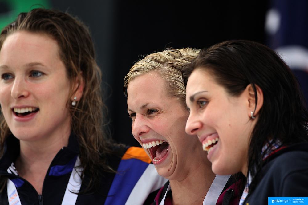 Lisbeth Trickett with Felicity Galvez (right)  and Marieke Guehrer after winning the women's 100m freestyle during the Australian Swimming Championships and Selection Trials for the XIII Fina World Championships held at Sydney Olympic Park Aquatic Centre, Sydney, Australia on March 19, 2009. Photo Tim Clayton