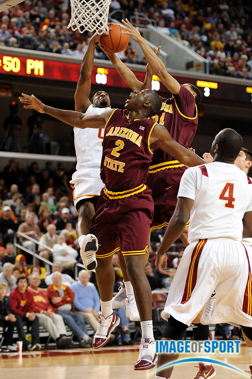 Jan 2, 2009; Los Angeles, CA, USA; Southern California Trojans forward Marcus Johnson (0) battles for a rebound with Arizona State Sun Devils center Eric Boateng (2) and guard Trent Lockett (24) at the Galen Center.