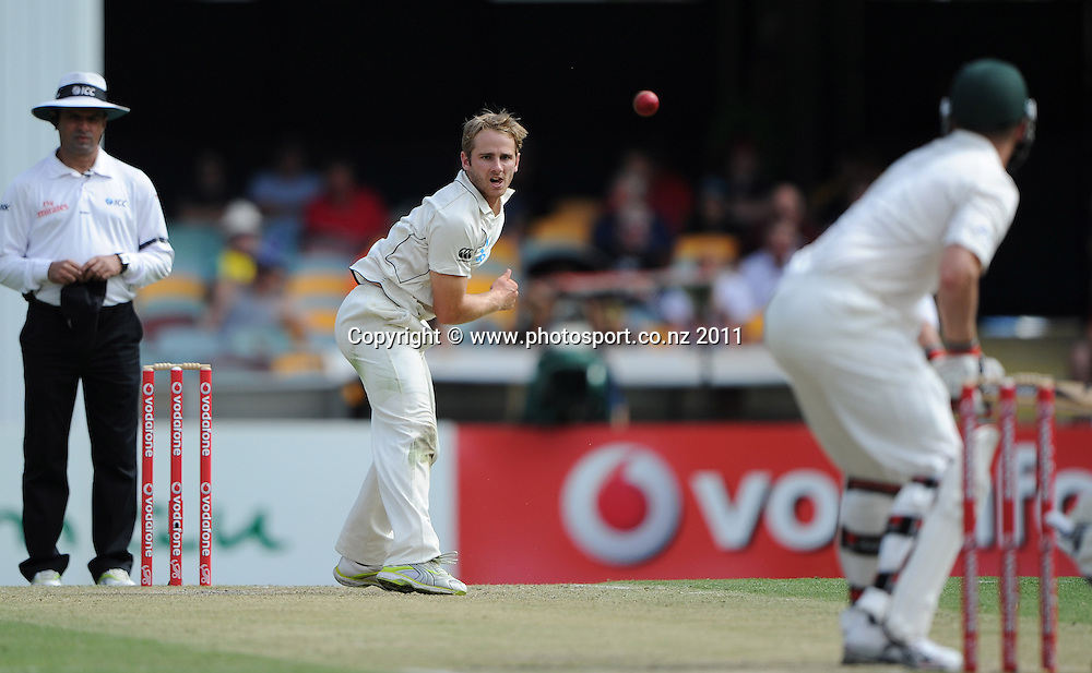 Kane Williamson bowling on Day 3 of the first cricket test between Australia and New Zealand Black Caps at the Gabba in Brisbane, Saturday 3 December 2011. Photo: Andrew Cornaga/Photosport.co.nz