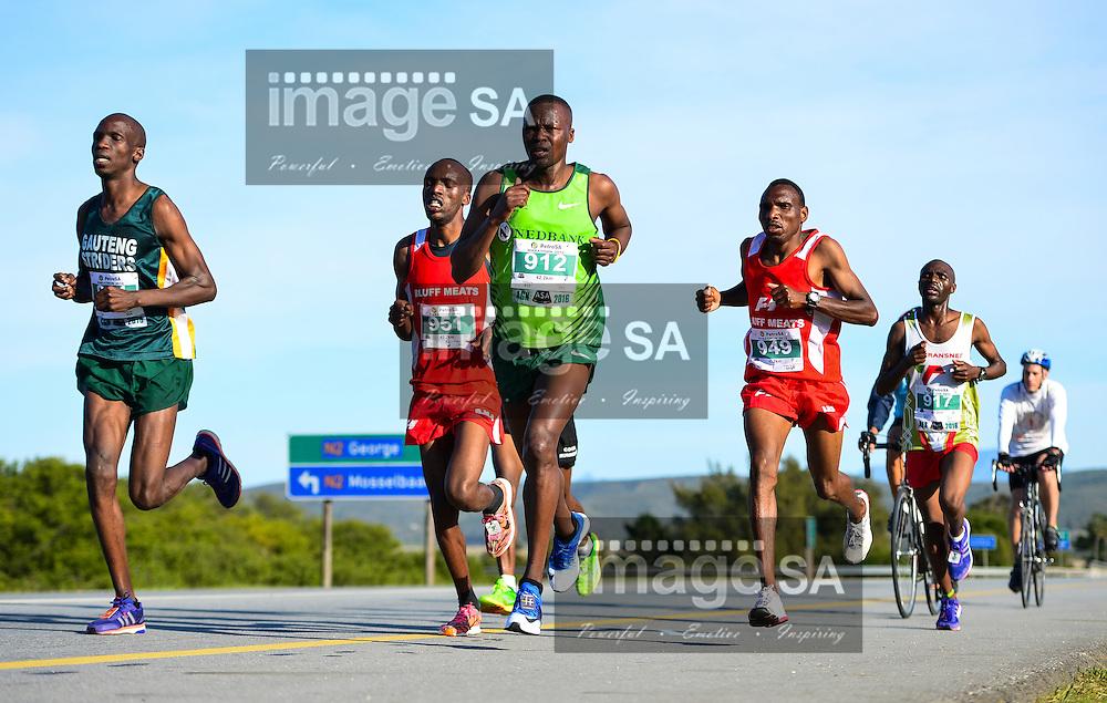 MOSSEL BAY, SOUTH AFRICA - SEPTEMBER 24: Vincent Kipchirchir (912) of Kenya leads during the PetroSA Marathon finishing at Santos Caravan Park on September 24, 2016 in Mossel Bay, South Africa. (Photo by Roger Sedres/Gallo Images)