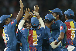 March 12, 2018 - Colombo, Sri Lanka - Sri Lankan cricketer Akila Dananjaya and his teammates celebrate after taking a wicket   during the 4th Twenty-20 cricket match of NIDAHAS Trophy between Sri Lanka  and India at R Premadasa cricket ground, Colombo, Sri Lanka on Monday 12 March 2018. (Credit Image: © Tharaka Basnayaka/NurPhoto via ZUMA Press)