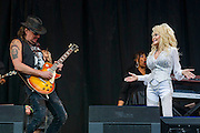 Dolly Parton and her special guest Riche Sambora, guitarist from Bon Jovi. The 2014 Glastonbury Festival, Worthy Farm, Glastonbury. 29 June 2013.  Guy Bell, 07771 786236, guy@gbphotos.com