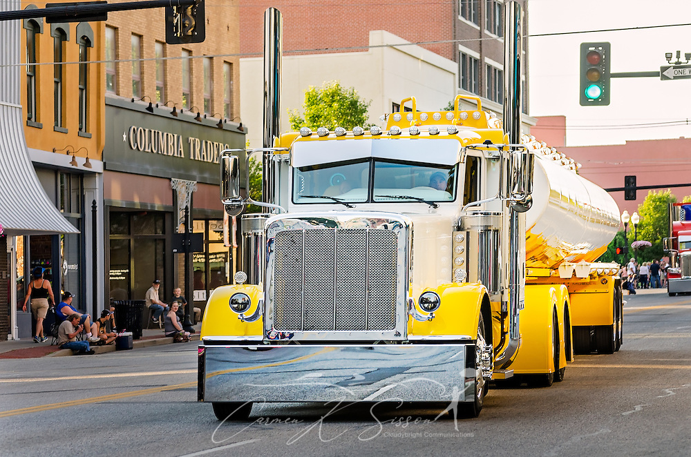 Rethwisch Transport's 2016 Peterbilt 386 with 2015 Mueller tank trailer, drives down Main Street during the 34th annual Shell Rotella SuperRigs parade, June 10, 2016, in Joplin, Missouri. SuperRigs, organized by Shell Oil Company, is an annual beauty contest for working trucks. Approximately 89 trucks entered this year's competition. (Photo by Carmen K. Sisson/Cloudybright)