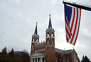 A large U.S. flag flies in honor of former House Speaker Thomas Foley before the Nov. 1, 2013 memorial service for him at St. Aloysius Church in Spokane, Wash. (Photo courtesy Gonzaga University.)