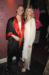 MAXIMILIAN WIEDEMANN and INA HOFMANN at a pajama party at The Cuckoo Club, Swallow Street, London on 2nd April 2008.<br />