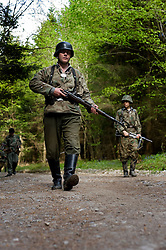 Reenactors from Northern World War Two Association, dressed as elements of the Elite Gross Deutschland Division patrol along a wooded road during a private 24hr excerise, held at Sutton Grange, near Ripon in Yorkshire 15  May 2010 .Images © Paul David Drabble.
