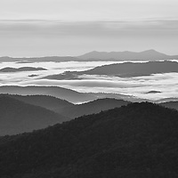 Black and white image of foggy valleys and Looking Glass Mountain area of Pisgah National Forest. Taken from Pounding Mill Overlook on the Blue Ridge Parkway, North Carolina.