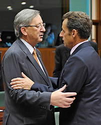 Jean-Claude Juncker, Luxembourg's prime minister, left, speaks with Nicolas Sarkozy, France's president, during the European Summit, in Brussels, Belgium, Wednesday, Oct. 15, 2008.   (Photo © Jock Fistick)
