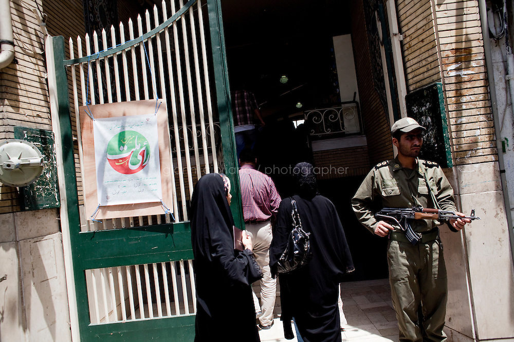12 June, 2009. Tehran, Iran. Voters enter a mosque in Tehran to cast their vote. Conservative reformist candidate Mir Hossein Mousavi is running against the ultra-conservative current President of Iran Mahmoud Ahmadinejad.<br /> &copy;2009 Gianni Cipriano<br /> cell. +1 646 465 2168 (USA)<br /> cell. +39 328 567 7923<br /> gianni@giannicipriano.com<br /> www.giannicipriano.com