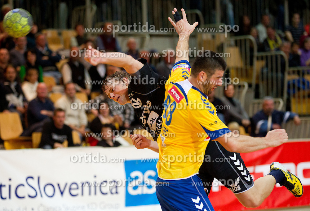 Jure Dolenec of Velenje vs Vladimir Osmajic of Koper during handball match between RK Cimos Koper and RK Gorenje Velenje of Slovenian Cup 2011/2012, on November 30, 2011 in Arena Bonifika, Koper, Slovenia. Cimos Koper defeated Gorenje Velenje 27-21 and qualified to quarterfinals. (Photo By Vid Ponikvar / Sportida.com)