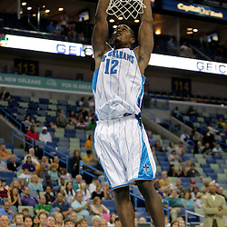 Oct 10, 2009; New Orleans, LA, USA; New Orleans Hornets center Hilton Armstrong (12) dunks against the Oklahoma City Thunder in the second quarter at the New Orleans Arena. Mandatory Credit: Derick E. Hingle-US PRESSWIRE