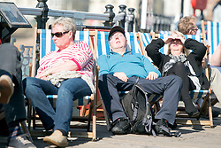 © Licensed to London News Pictures. 29/03/2014. Brighton, UK People relax in deck chairs on Brighton Pier. People enjoy the sunny weather in Brighton today 29th March 2014. The warm weather is forecast to remain into next week. Photo credit : Stephen Simpson/LNP