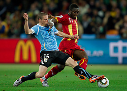 Diego Perez of Uruguay vs Sulley Muntari of Ghana during the  2010 FIFA World Cup South Africa Quarter Finals football match between Uruguay and Ghana on July 02, 2010 at Soccer City Stadium in Sowetto, suburb of Johannesburg. Uruguay defeated Ghana after penalty shots. (Photo by Vid Ponikvar / Sportida)