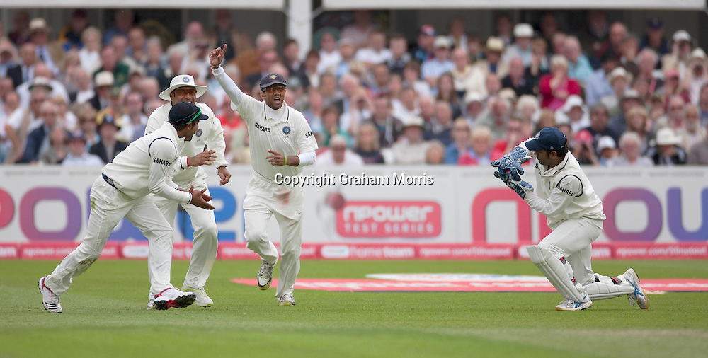 Celebrations as Ian Bell is out caught by wicket keeper Mahendra Singh Dhoni during the second npower Test Match between England and India at Trent Bridge, Nottingham.  Photo: Graham Morris (Tel: +44(0)20 8969 4192 Email: sales@cricketpix.com) 29/07/11