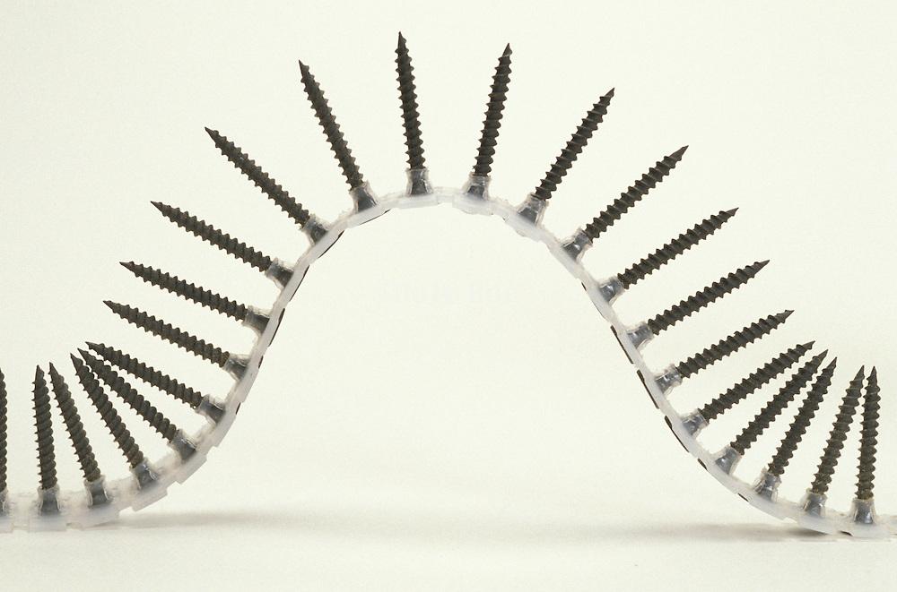 Still life of arching screws