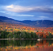 A Colorful And Pastoral Mountain Lake Scene On An Autumn Evening, Loon Lake, Adirondack Mountains, New York