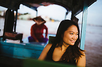 A young woman on a boat in the Mekong Delta in southern Vietnam.