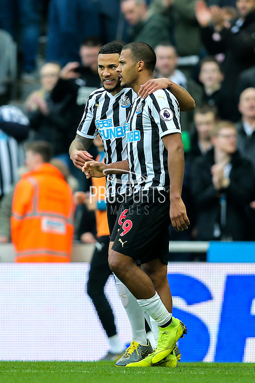 Jose Salomon Rondon (#9) of Newcastle United celebrates Newcastle United's first goal (1-0) with Jamaal Lascelles (#6) of Newcastle United during the Premier League match between Newcastle United and Huddersfield Town at St. James's Park, Newcastle, England on 23 February 2019.