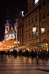 Prague, Czech Republic:  Old Town Square at night, with Tyn Church (Church of Our Lady Before Tyn) in the background.