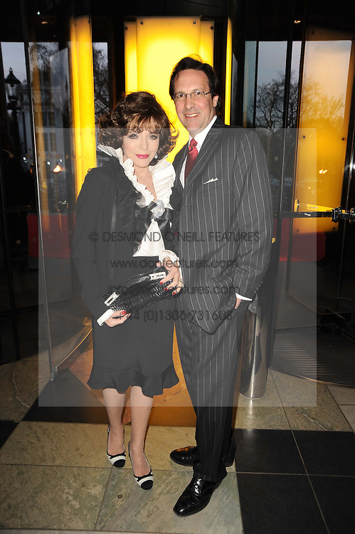 JOAN COLLINS and PERCY GIBSON at the opening of the Victoria & Albert Museum's latest exhibition 'Grace Kelly: Style Icon' opened by His Serene Highness Prince Albert of Monaco at the V&A on 15th April 2010.