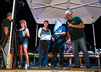 John and Brenda Ganong, Jennifer Anderson and Peddlar Bridges were among the the award recipients for bringing the first annual Biketemberfest to Weirs Beach.  Awards given by Nick Tamposi on stage Saturday evening.    (Karen Bobotas/for the Laconia Daily Sun)
