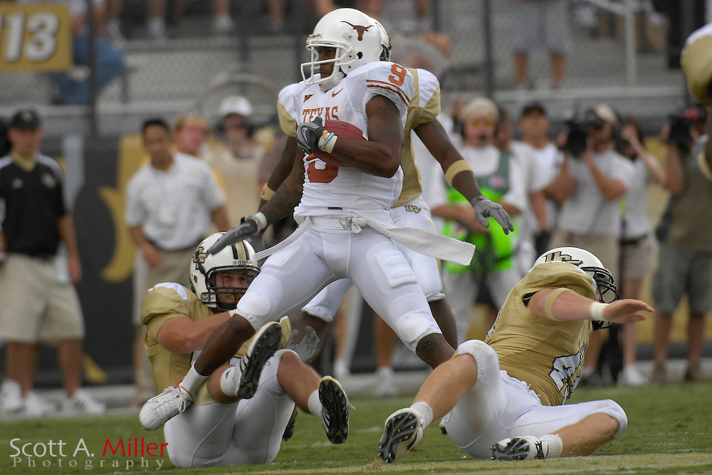 Sep 15, 2007; Orlando, FL, USA; Texas Longhorns receiver (9) Nate Jones spins away from Central Florida Knights defenders during the first quarter in Bright House Stadium. ...©2007 Scott A. Miller