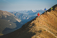 Brian Smith, Bryan Wickenhauser, and Jon Brown running the ridgeline of Mount Bellview, Crested Butte, Colorado.