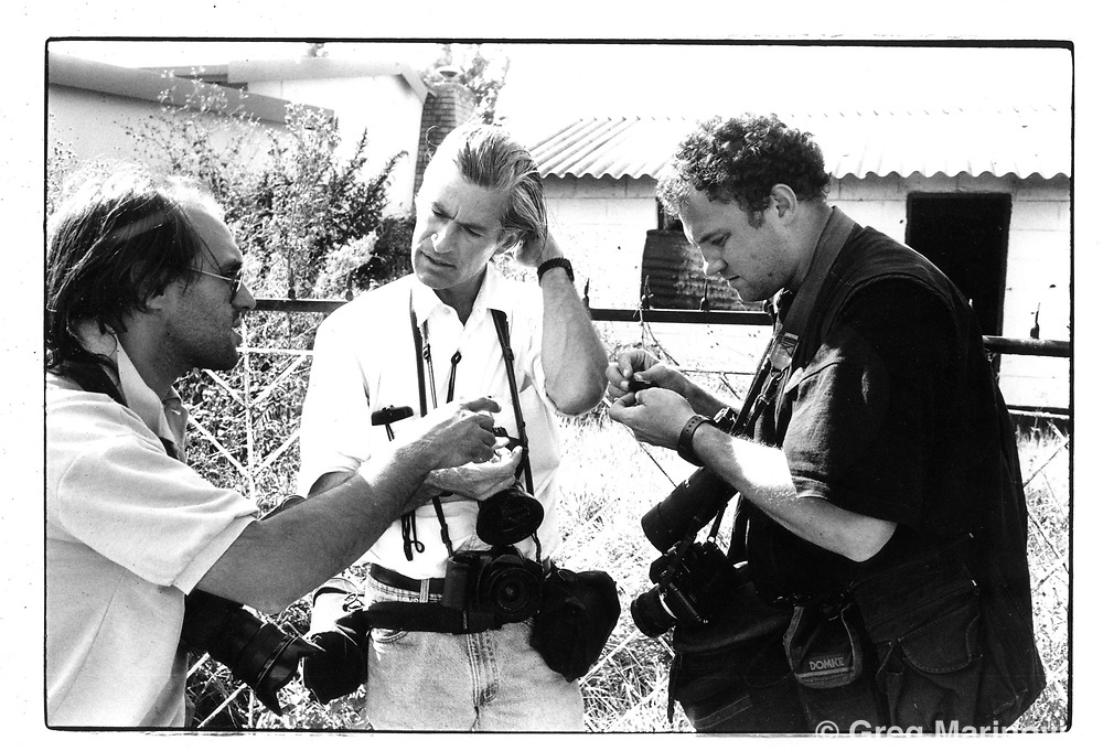 Joao Silva, Jim Nachtwey and Greg Marinovich in Thokoza, South Africa April 18, 1994. The second last frame shot on Ken Oosterbroek's Leica m6 before he was shot in Thokoza, April 18, 1994.  Collection of Greg Marinovich.