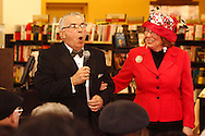 Kettering city councilman Tony Klepacz reacts to emcee Sharon Howard as he escorts model Montgomery County Commssioner Judy Dodge to the runway during the Crowns Hat Fashion Show at Books & Company in The Greene in Beavercreek, Saturday, February 23, 2013.