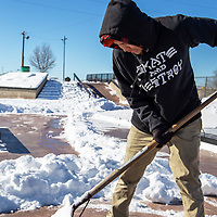 Sonnie Sam, 13, dedicated his Thursday morning to shoveling snow at the skate park in Gallup so he could return to skating sooner.