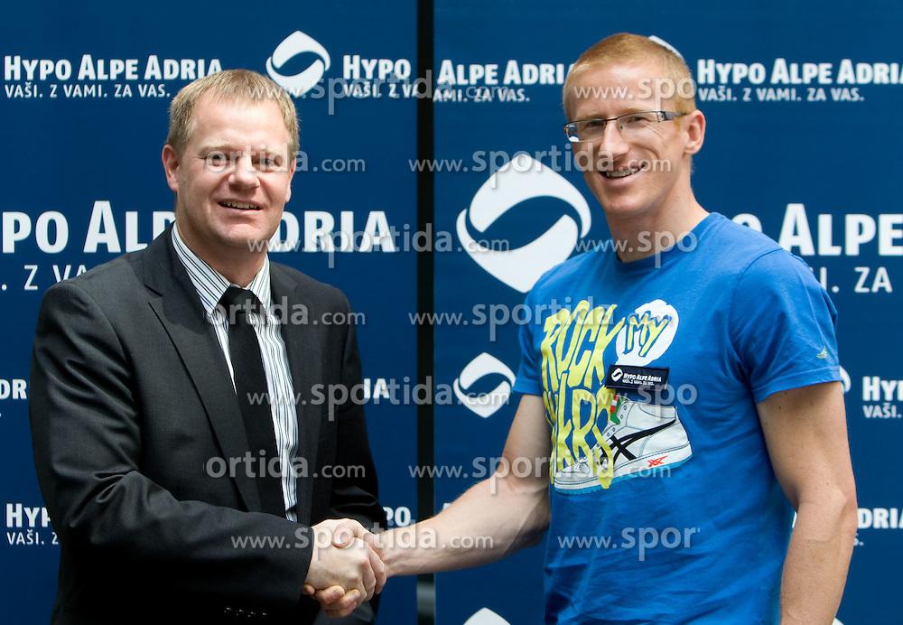 Tomaz Krajncic of Hypo Alpe Adria signed a sponsorship contract with Slovenian athlete Matic Osovnikar at press conference, on June 21, 2011, in Rotonda, Ljubljana, Slovenia. (Photo by Vid Ponikvar / Sportida)