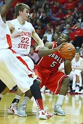 04 February 2012:  Jalen Crawford works to the basket guarded by Jon Ekey during an NCAA Missouri Valley Conference mens basketball game where the Bradley Braves lost to the Illinois State Redbirds 78 - 48 in Redbird Arena, Normal IL