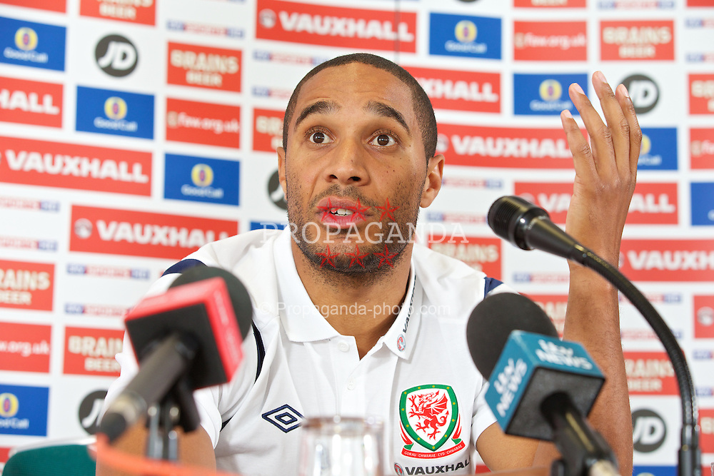 CARDIFF, WALES - Tuesday, August 13, 2013: Wales' captain Ashley Williams during a press conference at the St. David's Hotel ahead of the International Friendly match against the Republic of Ireland. (Pic by David Rawcliffe/Propaganda)