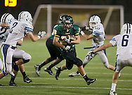 Kennedy's Alexander Hillyer (28) tries to run between Jefferson's Anthony Shumacher (2) and Blake Bernauer (6) during first quarter of the game between Cedar Rapids Jefferson and Cedar Rapids Kennedy at Kingston Stadium in Cedar Rapids on Friday September 28, 2012. It was 24-0 Kennedy at halftime.