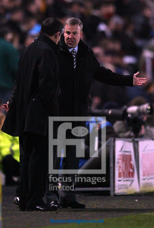 Hull - Saturday, January 24th, 2009: Hull City manager Phill Brown and Millwall manager Kenny Jackett exchange words after a vicious tackle by a milwall defender during the FA Cup fourth round match at the KC Stadium, Hull. (Pic by Darren Walker/Focus Images)