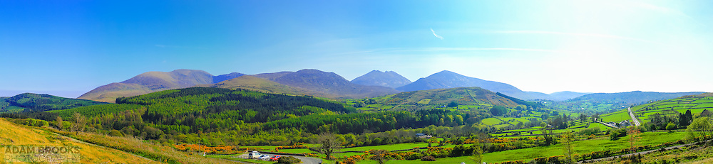 View overlooking the Mournes from Moneyscalp Wood just off the High Mournes Scenic loop. Includes, from left, Tollymore Forest Park, Shan Slieve, Slieve Commedagh, Slieve Corragh, Slievenalough, Slieve Bearnagh, Slieve Meelmore and the road onwards to the High Mournes Scenic loop.