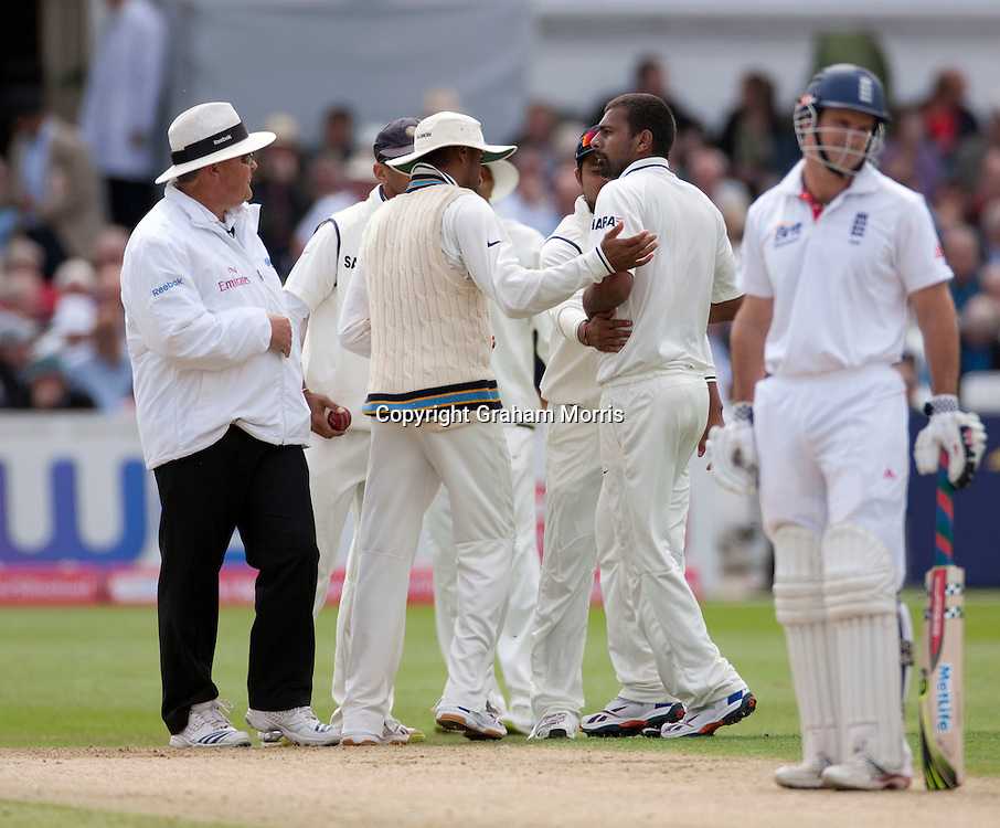 Bowler Praveen Kumar (right) has words after the lbw of Kevin Pietersen is turned down by umpire Marais Erasmus during the second npower Test Match between England and India at Trent Bridge, Nottingham.  Photo: Graham Morris (Tel: +44(0)20 8969 4192 Email: sales@cricketpix.com) 29/07/11